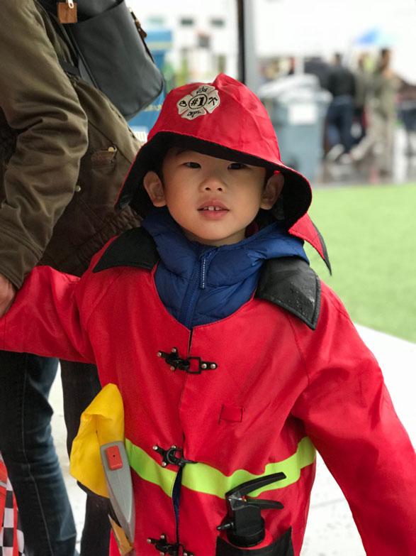 Monster mash little boy in fireman costume